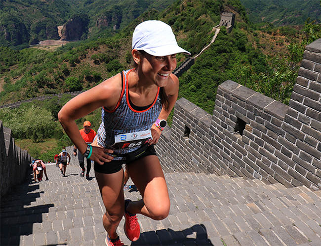Woman running a marathon on the Great Wall of China